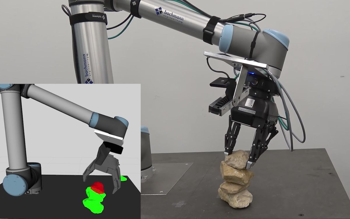 Robot arm carefully stacks rocks one on top of another