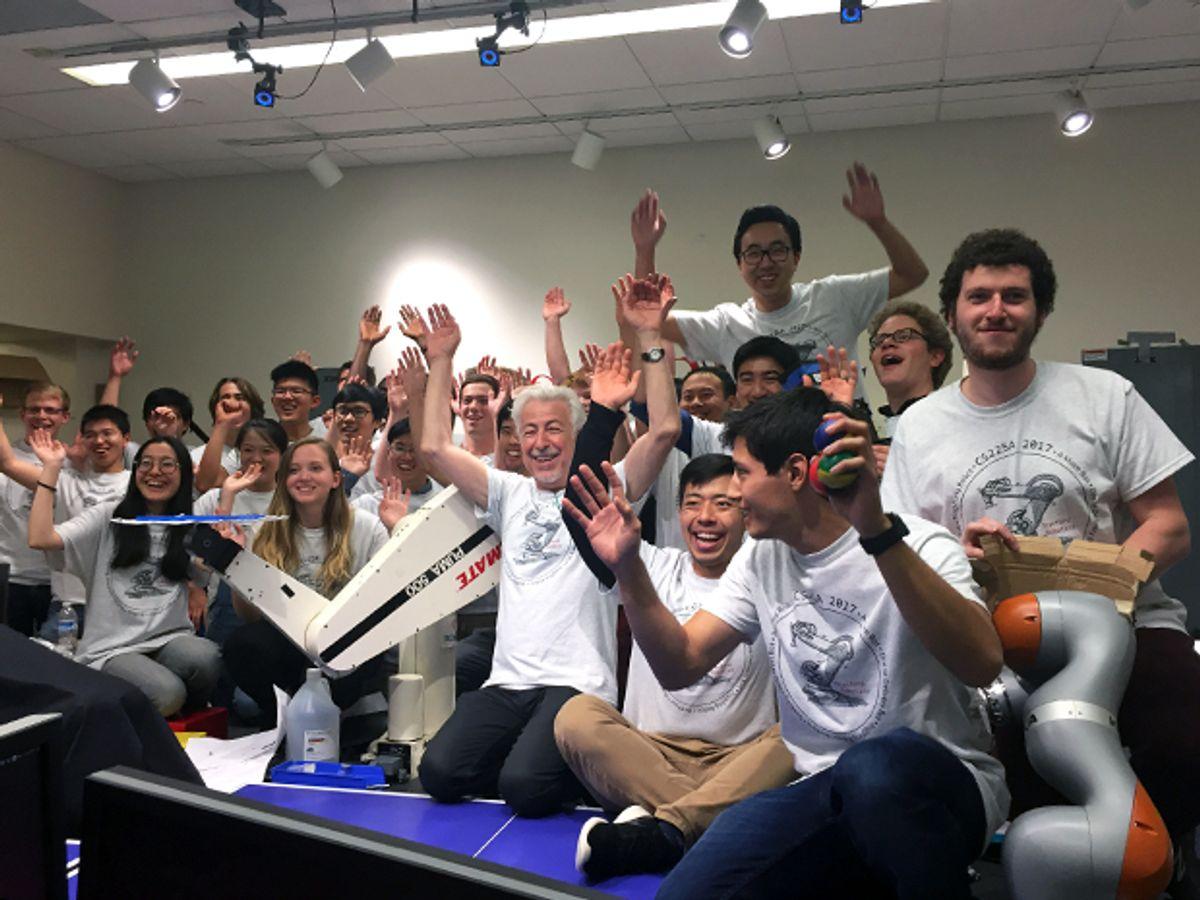 Students in Stanford's Experimental Robotics class gather around professor Oussama Khatib