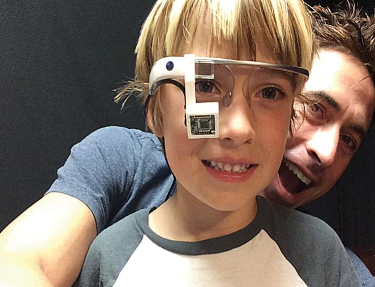 Photo of boy wearing smart glasses.