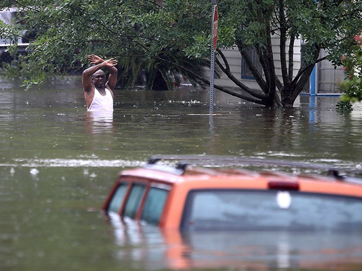 A resident calls out to a rescue crew in a flooded Houston neighborhood after Hurricane Harvey struck the region.