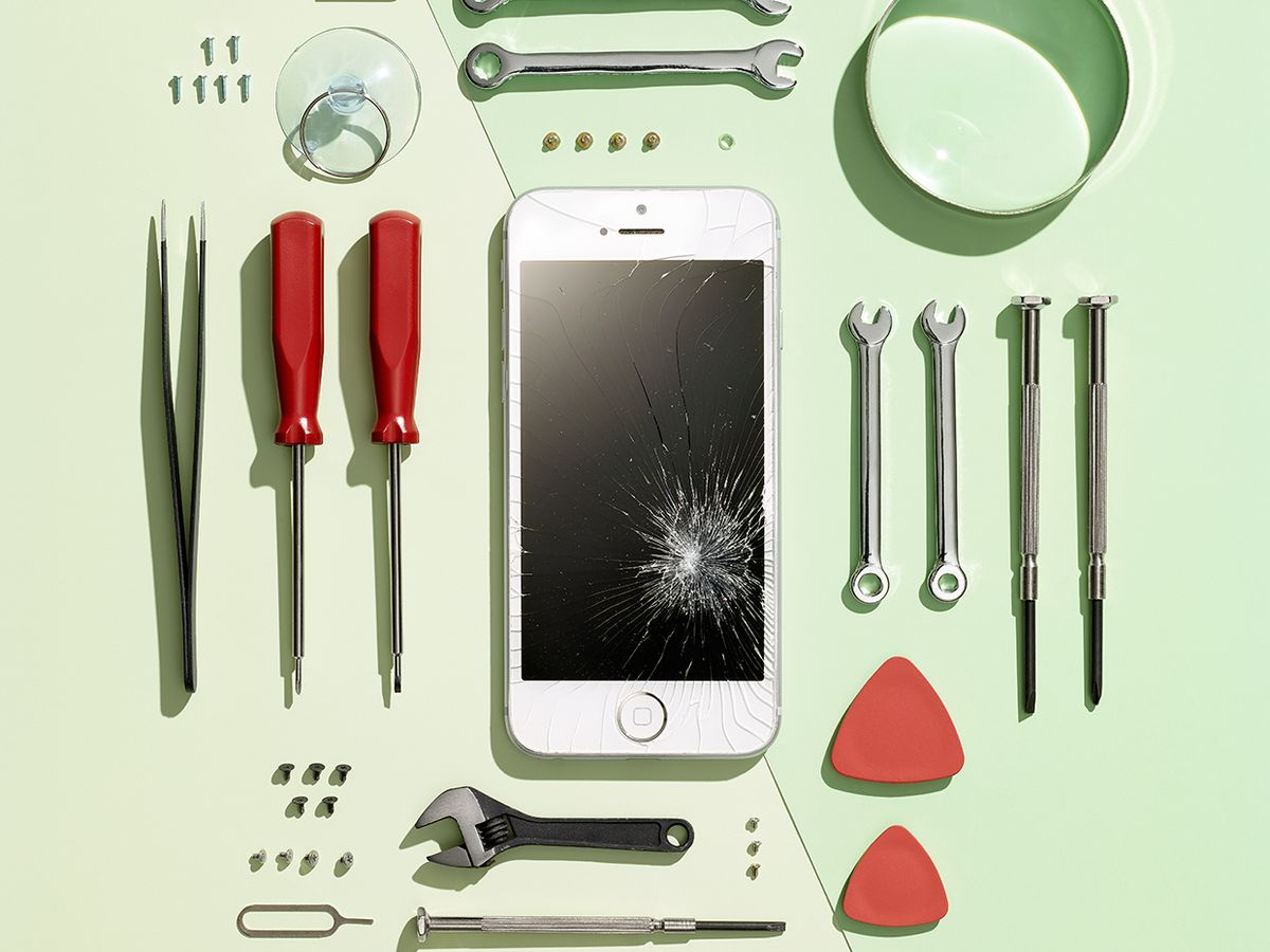 Photo of a smart phone surrounded by tools