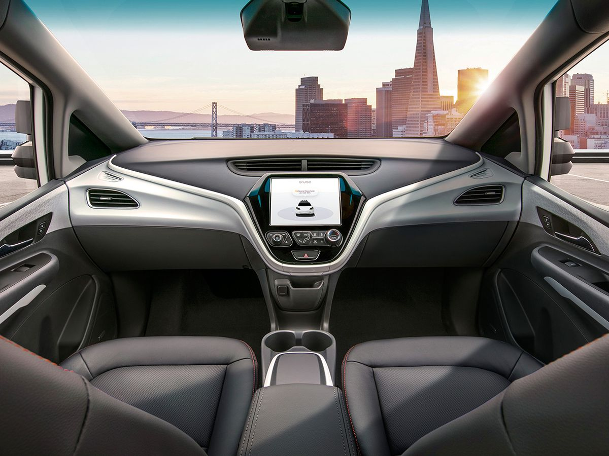 Photograph showing the steering wheel-free view inside of GM's Cruise self-driving car.