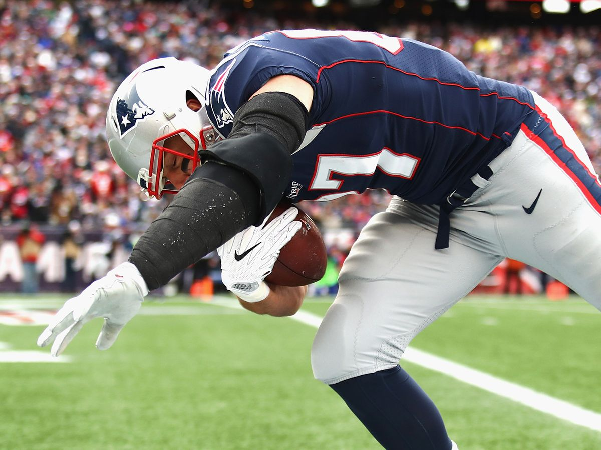 Rob Gronkowski #87 of the New England Patriots falls into the end zone after catching a touchdown pas