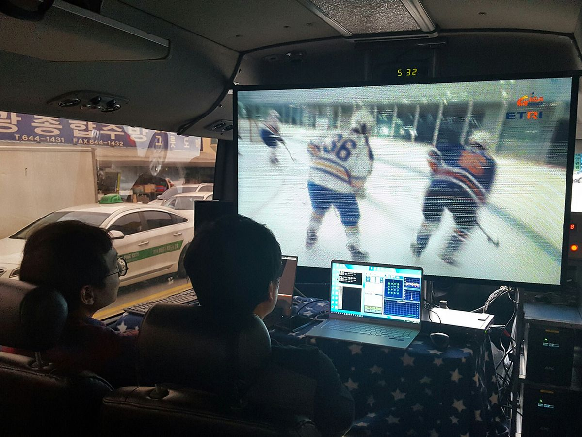 Users aboard 5G Champion's demo bus watch an ice hockey game streaming at 5 Gbps from a nearby 5G basestation.