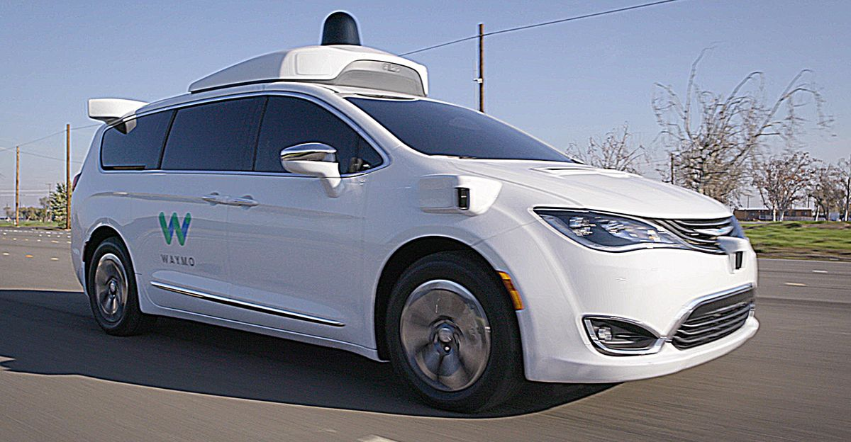 Pacifica Hybrid minivan driving on Waymo's test track in California for illustrative purposes