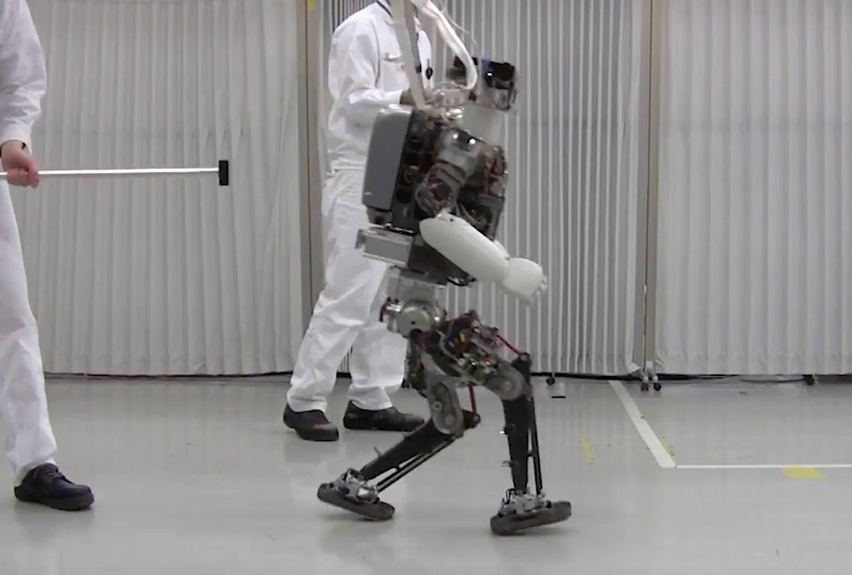 Honda's humanoid robot Asimo is learning how to hop and jog to keep itself from falling over