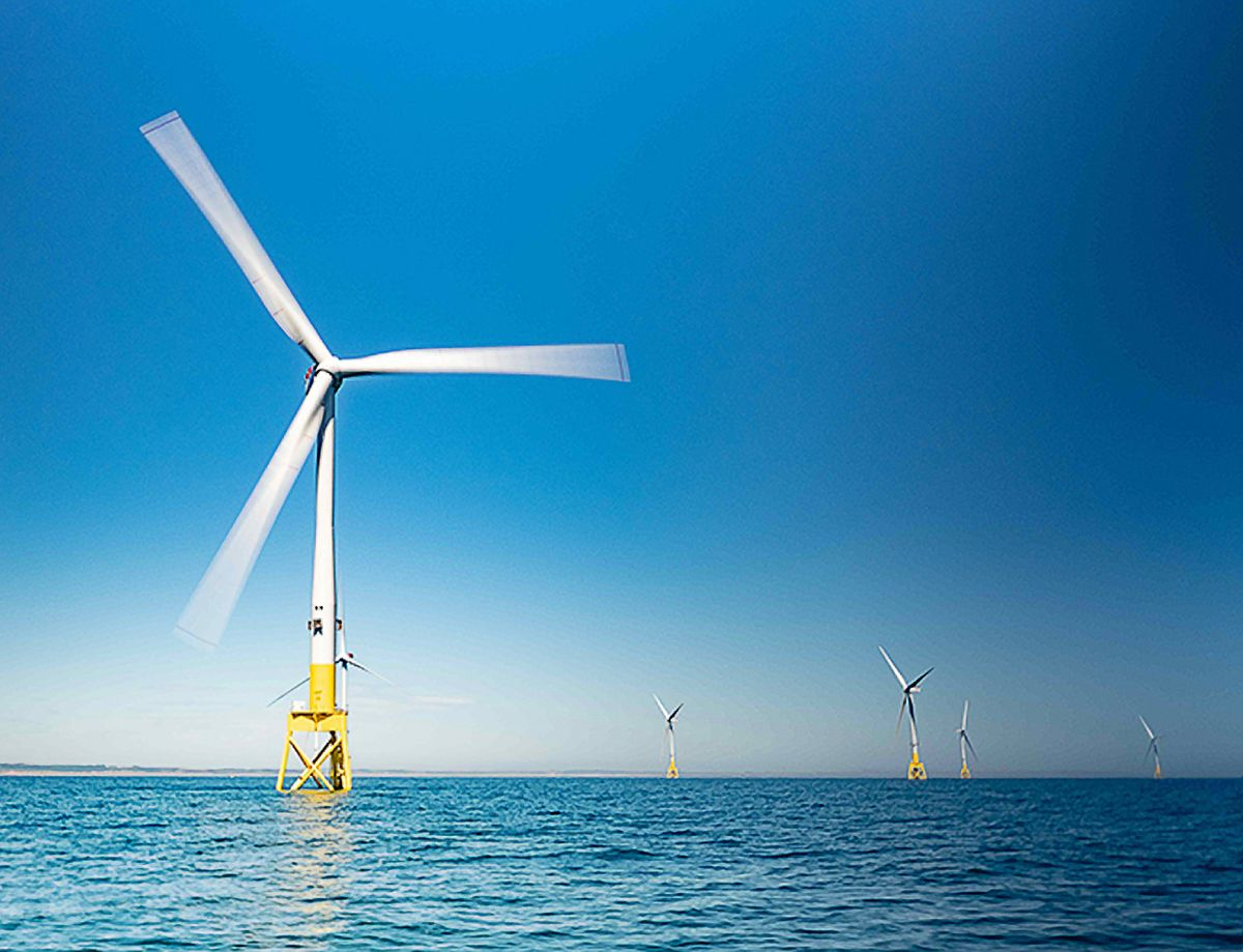 Photo of a wind turbine over water.