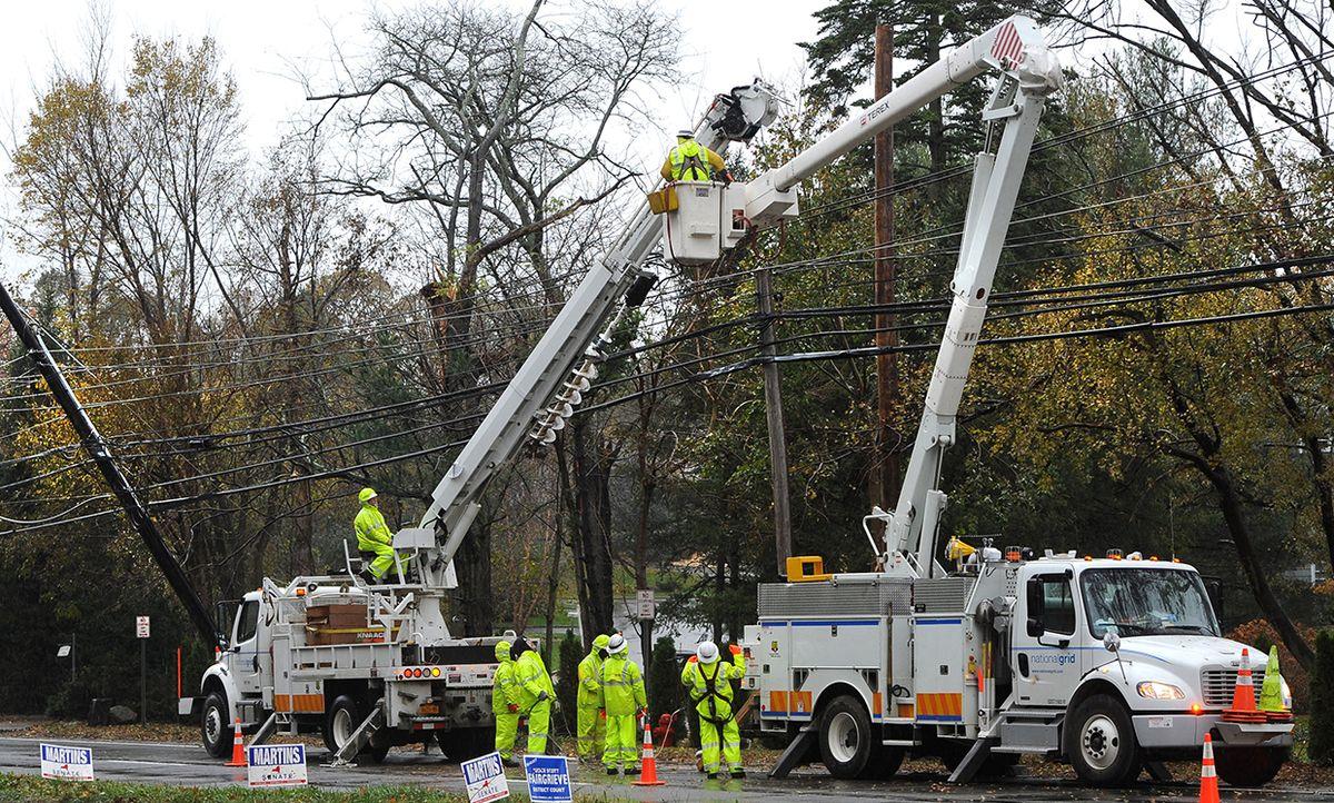 National Grid workers repair power lines damaged during Superstorm Sandy in Port Washington, N.Y., Nov. 7, 2012.