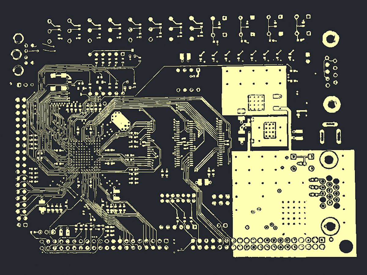 X-ray tomography image reveals a layer of the layout of a commercial printed circuit board.