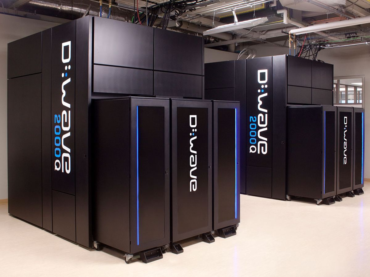 A photo of the D-Wave 2000Q which looks like large black boxes emblazoned with the D-Wave name in white, arranged in a room.