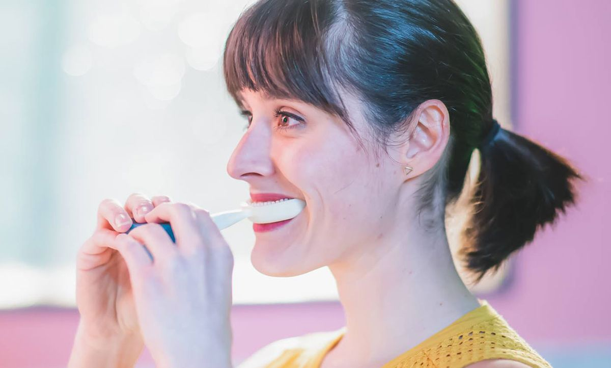 The Y-Brush cleans all of your teeth in 10 seconds.