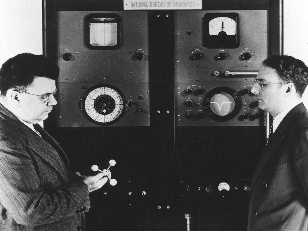 Edward U. Condon [left], director of the National Bureau of Standards, with Harold Lyons, inventor of the ammonia absorption cell atomic clock [above].