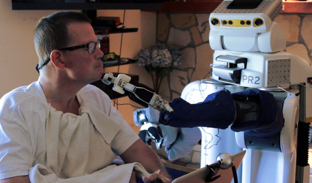 Henry Evans, a California man who participated in Georgia Tech's study, used a PR2 robot to shave, wipe his face, and scratch his head.