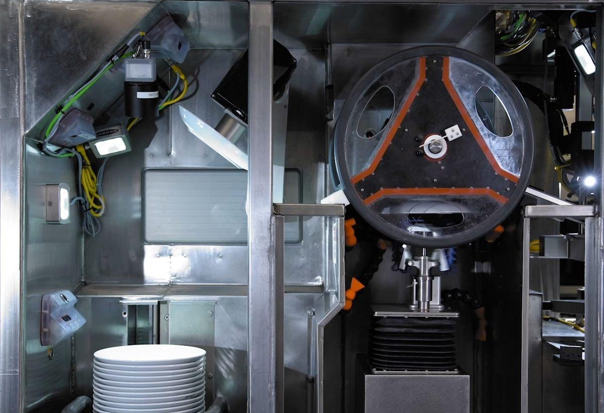 The Dishcraft Robotics dish washing robot system uses a robotic arm and AI