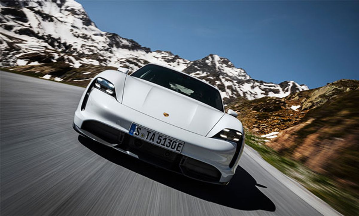 Image of a Porsche with a picturesque landscape in the background.