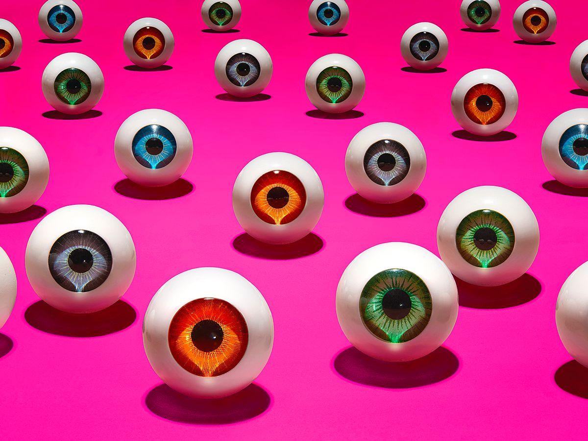 illustration of eyes on bright pink background