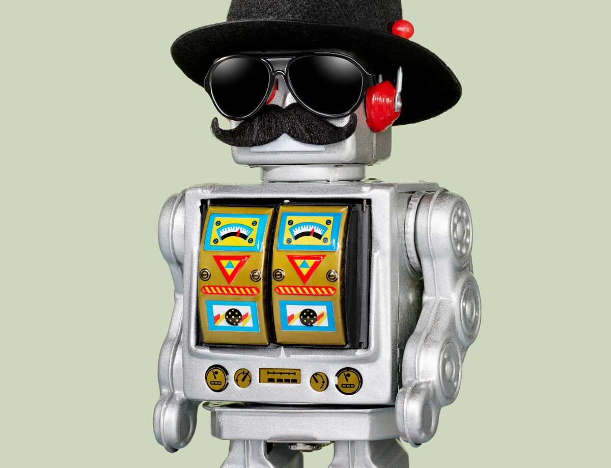 Photo of a toy robot wearing a hat, dark sunglasses and a mustache.