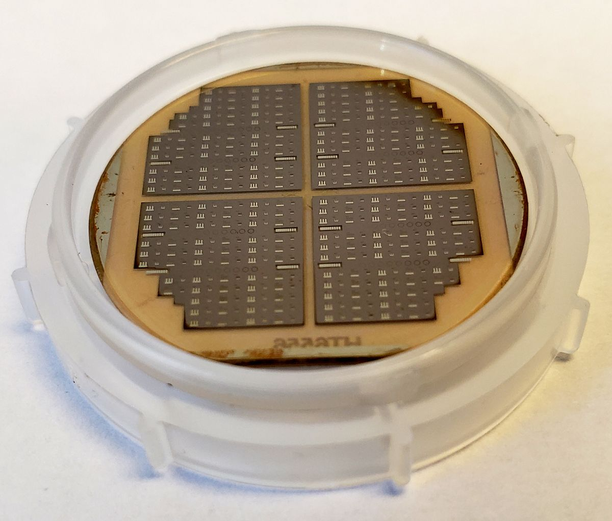 Many UV LEDs fabricated by Adroit Materials on AlN wafer from HexaTech