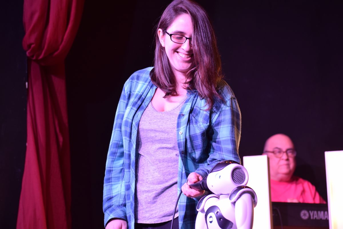 Roboticist and comedian Naomi Fitter with her Nao robot during a stand-up performance