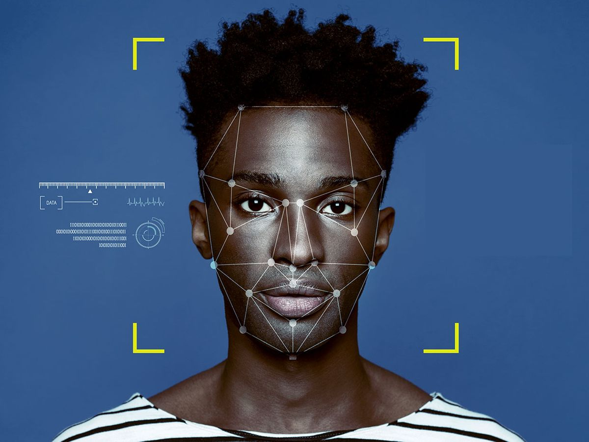 Portrait of a young black man with facial recognition markers on his face