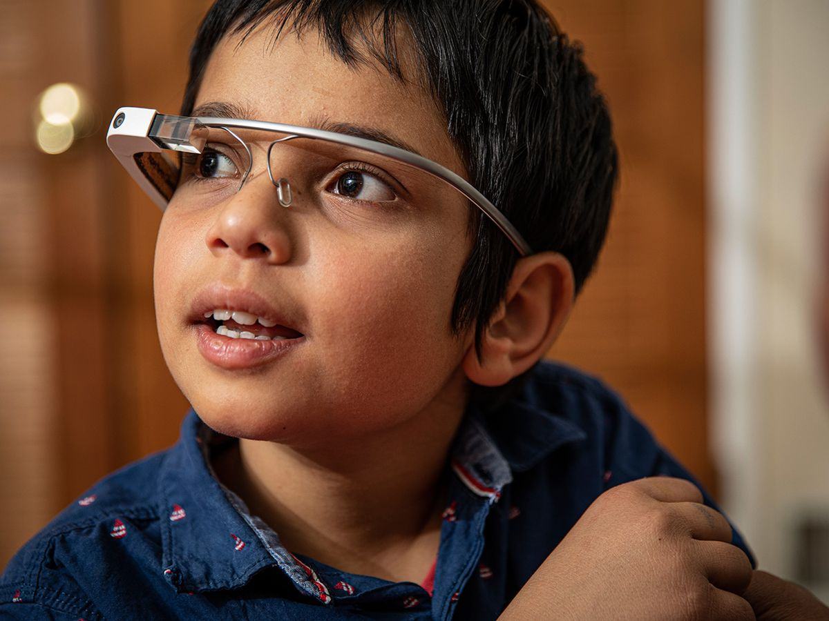 Vivaan Ferose, an 11-year-old boy with autism, wears his Google Glass head-up display.