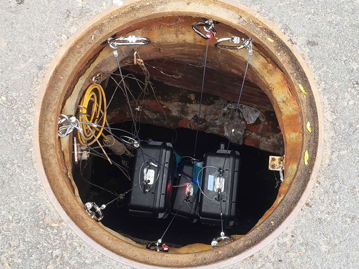 2019 photo of 3 Biobot Analytics robots in a sewer