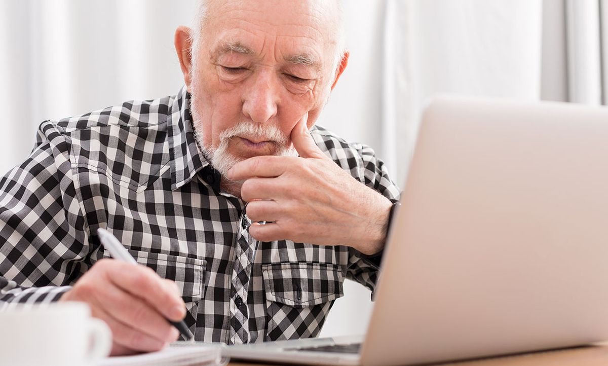 Stock photo of a senior man working on a computer