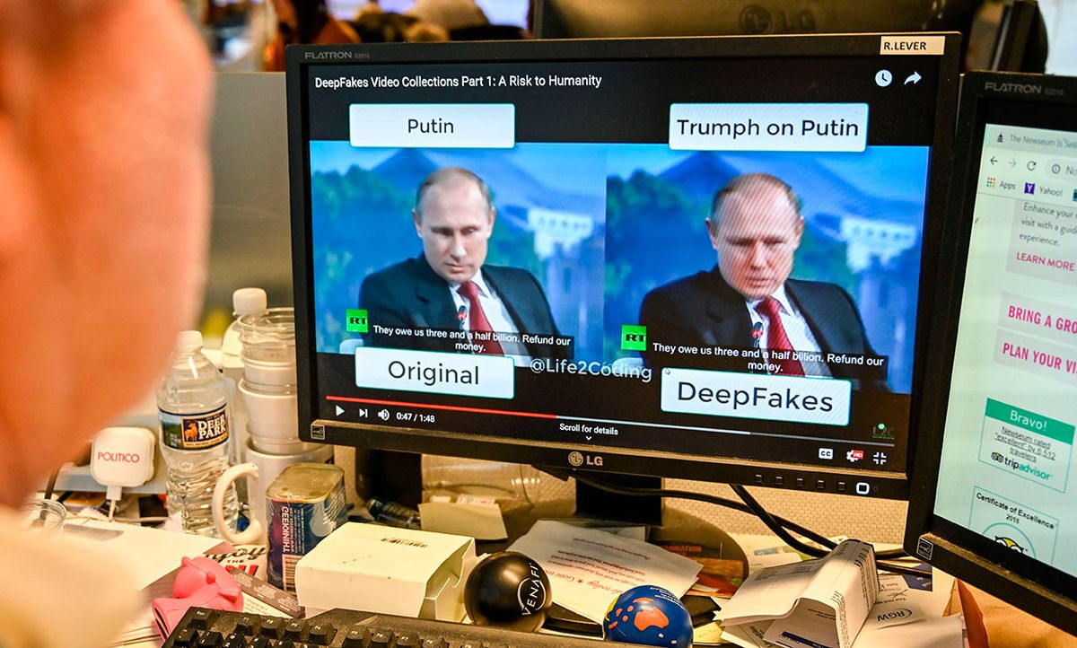 """A journalist views a video manipulated with artificial intelligence to potentially deceive viewers, or """"deepfake"""" at his newsdesk in Washington, DC"""