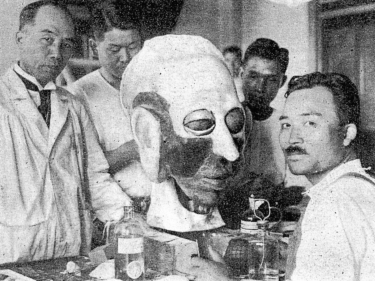 Makoto Nishimura [left] and his team designed Gakutensoku's head so that it could express human affect.