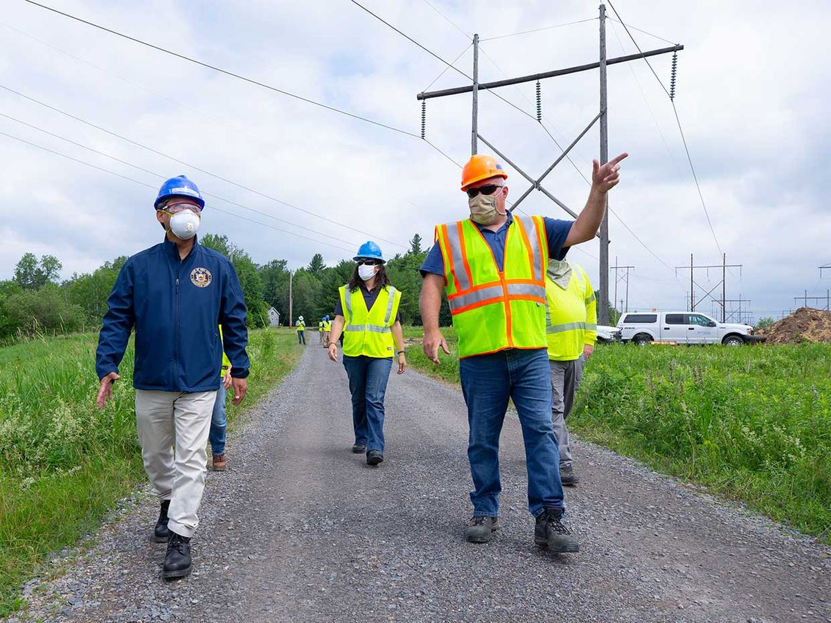 Executives from the New York Power Authority observe progress on a transmission-line project.