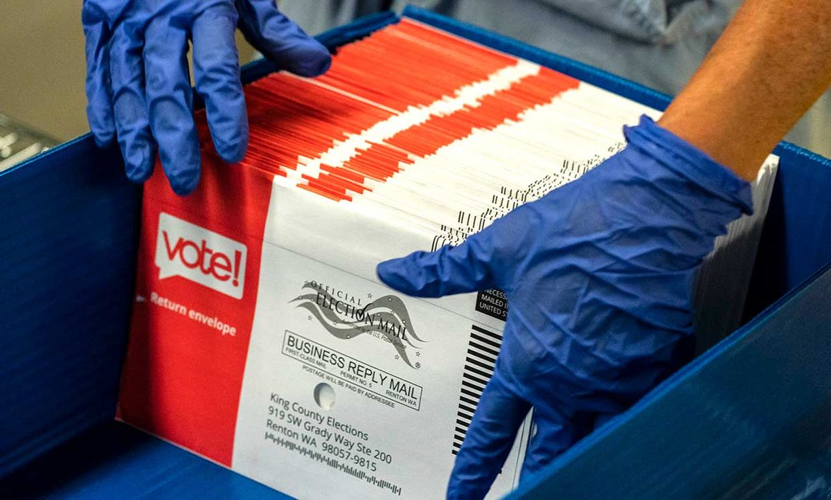 An elections worker sorts unopened ballots at the King County Elections headquarters on August 4, 2020 in Renton, Washington. Today is election day for the primary in Washington state, where voting is done almost exclusively by mail.