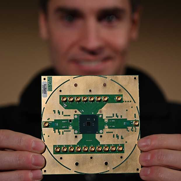 Stefano Pellerano, principal engineer at Intel Labs, holds Horse Ridge, a cryogenic control chip