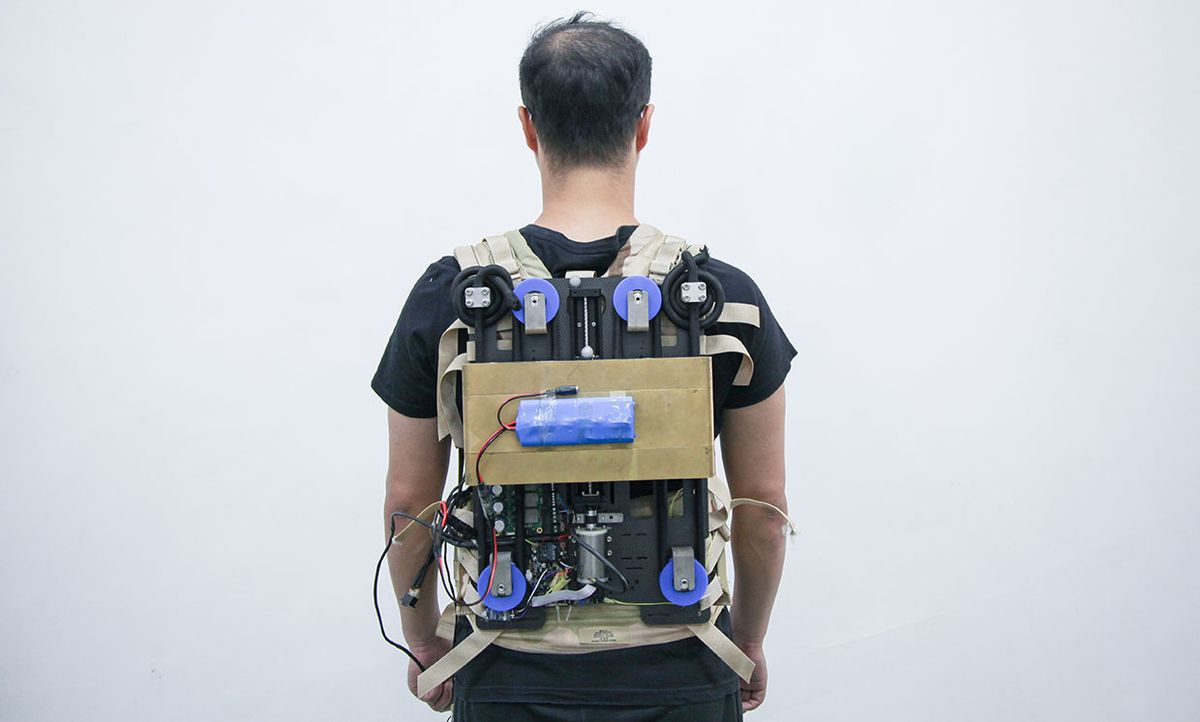 A student wearing the backpack prototype.