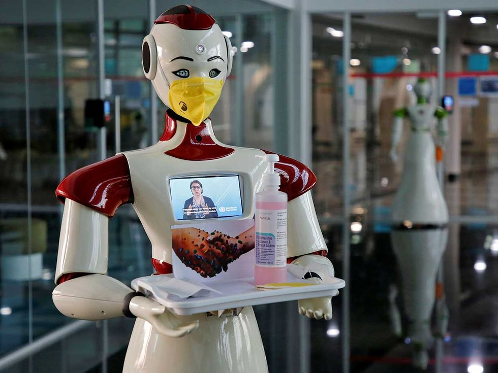 A robot, developed by Asimov Robotics to spread awareness about the coronavirus, holds a tray with face masks and sanitizer.