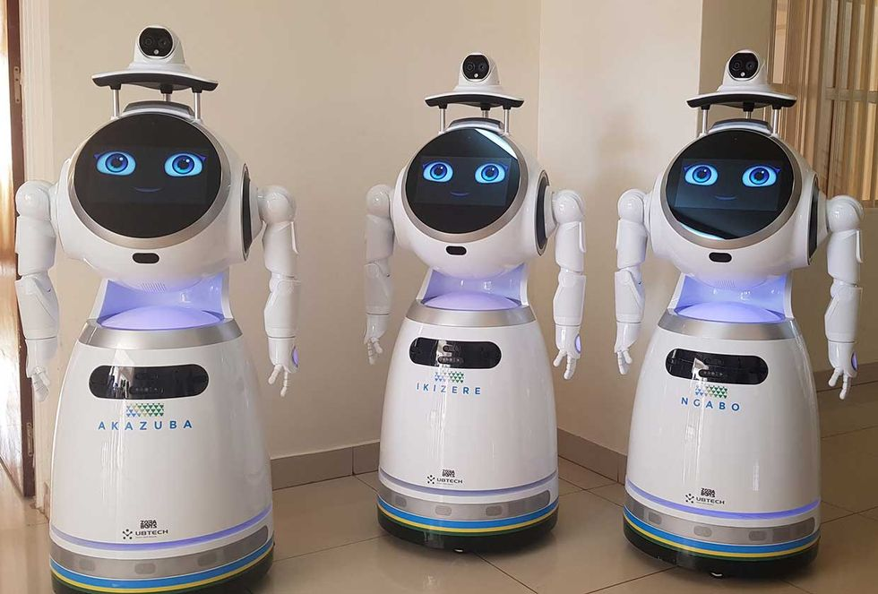 A squad of robots serves as the first line of defense against person-to-person transmission at a medical center in Kigali, Rwanda.
