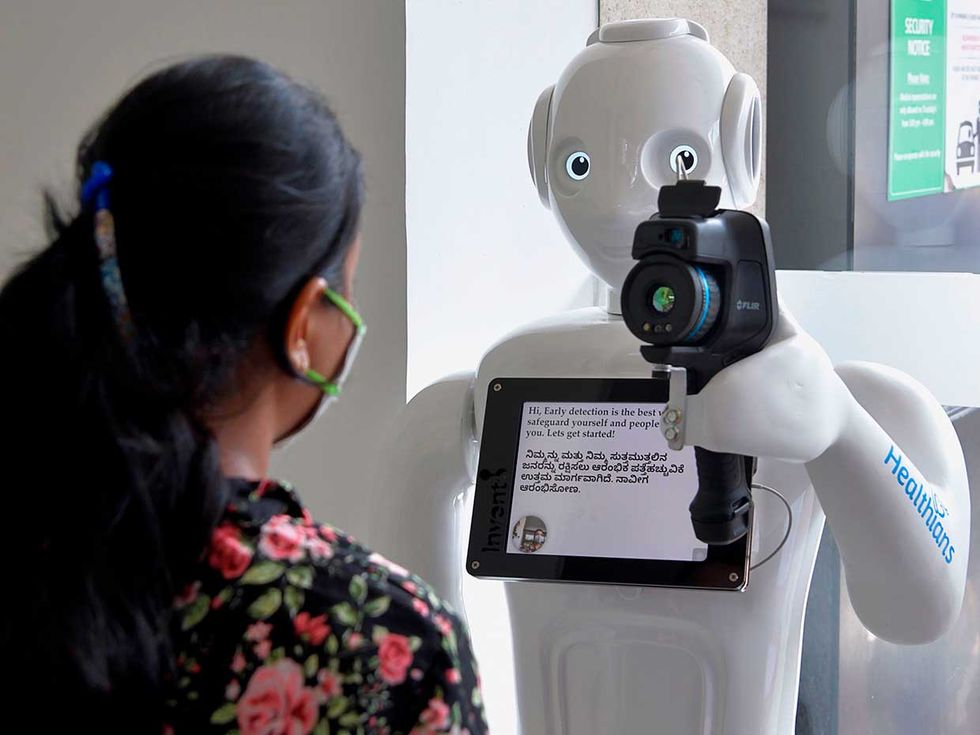 At Fortis Hospital in Bangalore, India, a robot called Mitra uses a thermal camera to perform a preliminary screening of patients.