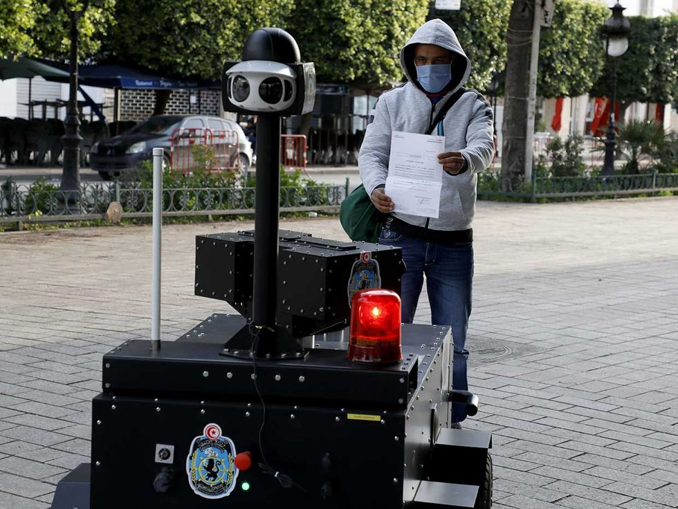 In Tunisia, the police use a tanklike robot to patrol the streets of its capital city, Tunis, verifying that citizens have permission to go out during curfew hours.