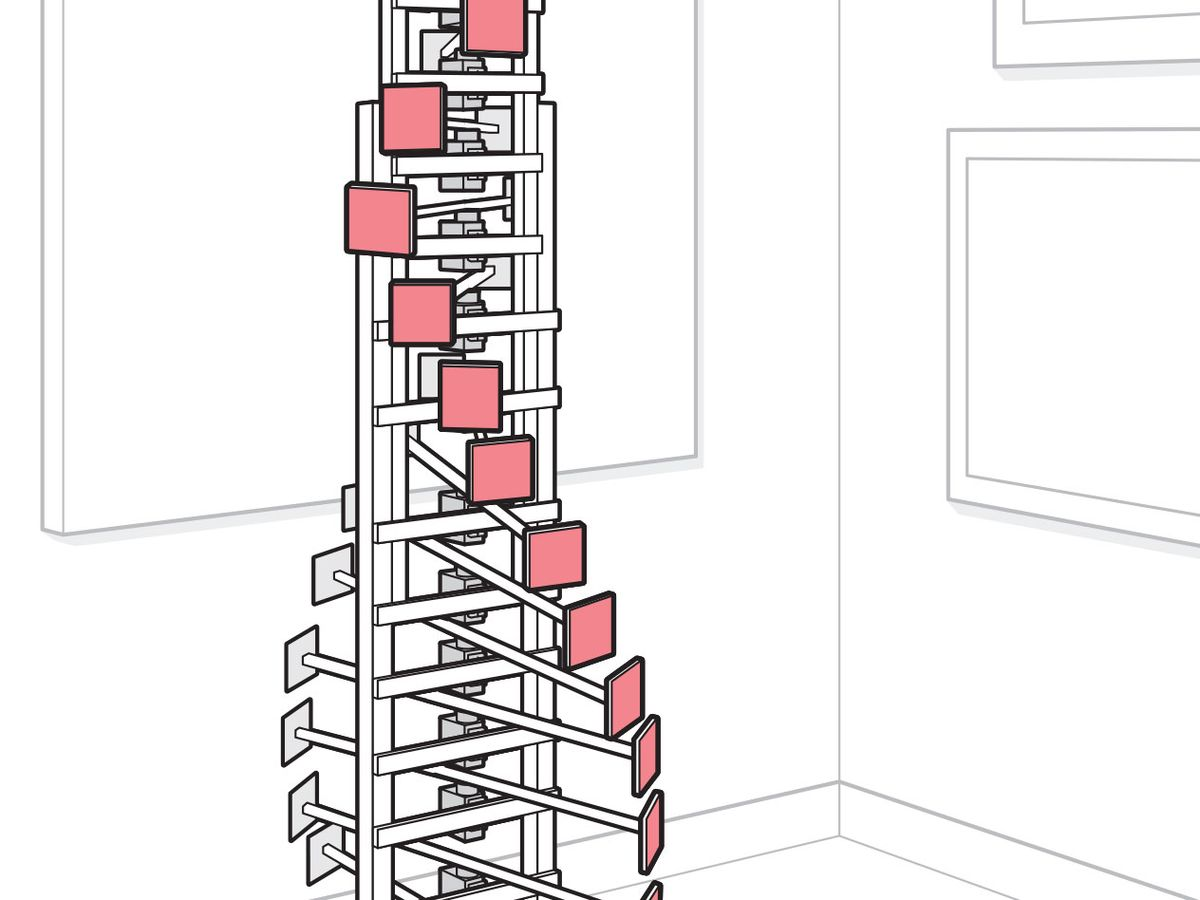 A DIY kinectic sculpture with 18 beams with a colored tile at each end