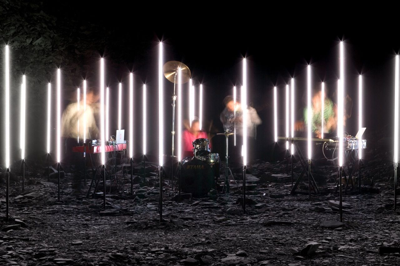 To create a music video for the band Battles, UVA positioned a triangular grid of vertical LED columns in a unused slate quarry in Wales. The designers knew they'd have at most a day to film the video, so they created a detailed simulation of the performance in their London studio beforehand.