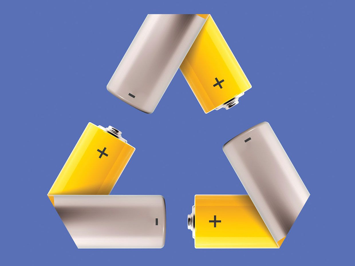 Photo illustration of the recycle symbol made up of batteries.