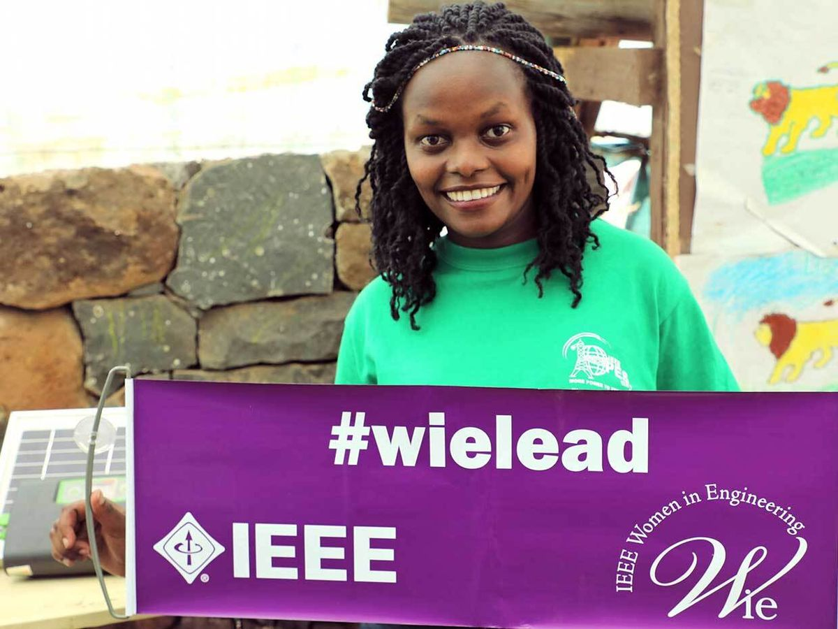 A woman holding a sign #wielead