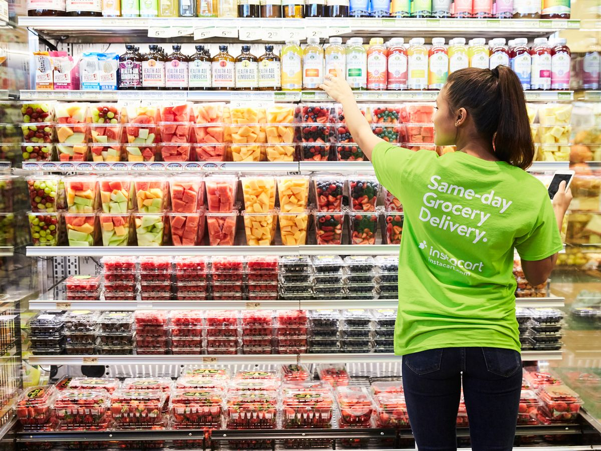 Image of a Instacart shopper reaching for a orders item.