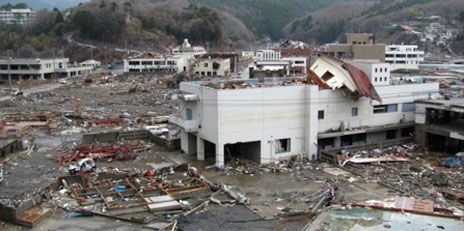 After the tsunami, NTT's central office building in Onagawa had the remains of a house on its roof.