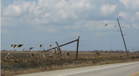 Poles snapped by Ike brought down the only power line serving the Bolivar Peninsula.