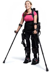 User Tamara Mena, who was paralyzed in 2005, gleefully puts her exoskeleton walking suit through its paces.