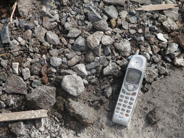 A mobile phone left in the rubble in Yamada, Japan