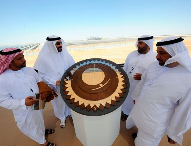 A SUNNY DELIGHT: Celebrants at the official opening of the 100-megawatt Shams 1 solar power plant in Abu Dhabi in March.