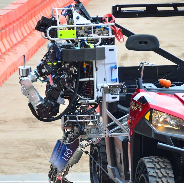 Humanoid getting off car during DARPA Robotics Challenge