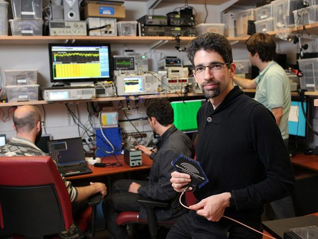 Eran Tromer and colleagues in a lab