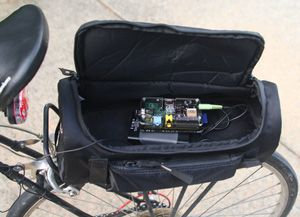 photo of unit fitting into bicycle saddlebag